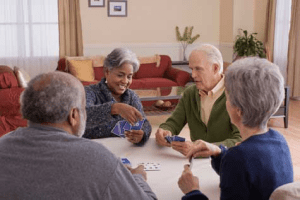 Seniors playing poker in an adult daycare center