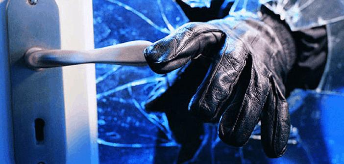 A burglar's hand grabbing the door