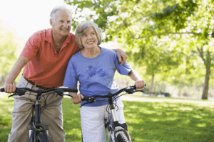 An elderly couple enjoying the shared bycicle tour