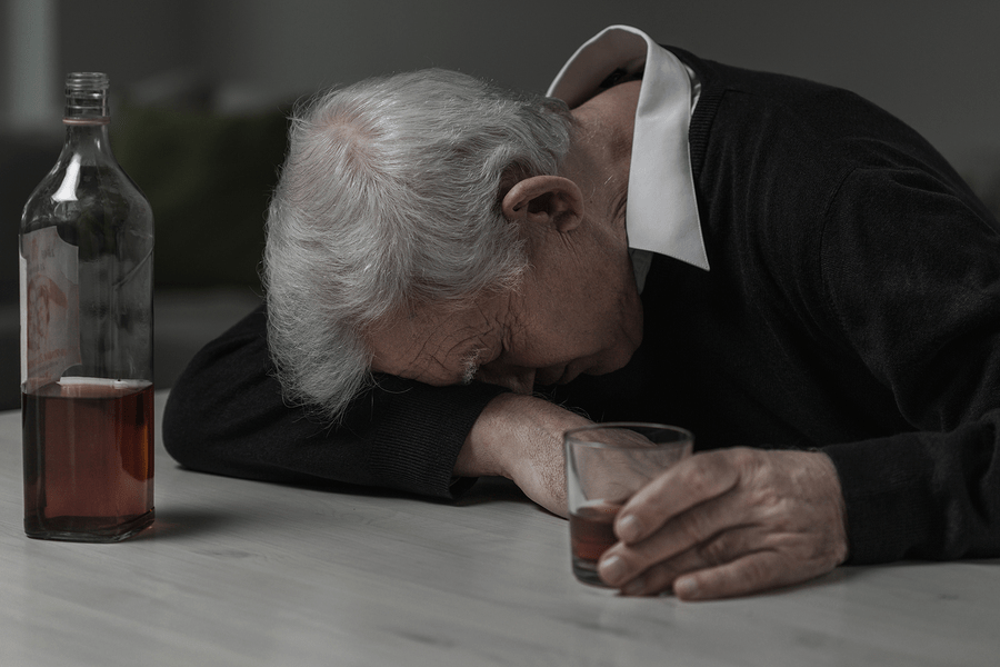 An elderly passed out after drinking too much