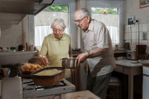Elderly couple cooking