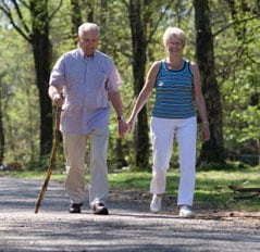 Elderly couple going for a stroll