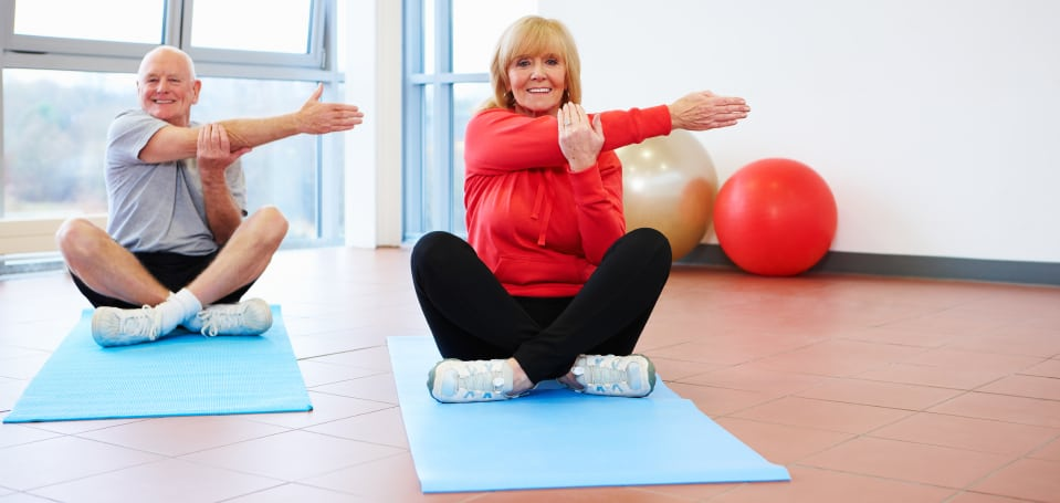 Couple seniors doing exercises