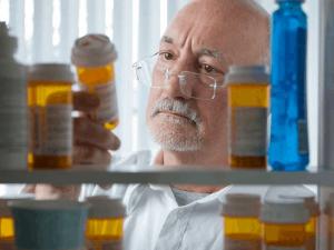 Elderly inspecting his medicin