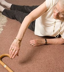 Elderly lady laying on the floor