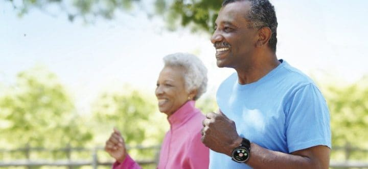 Elderly couple wearing smartwatches