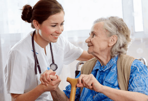 An elderly receiving emotional support from a caregiver
