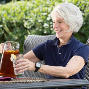 Elderly woman enjoying freedom with her smart emergency wristwatch