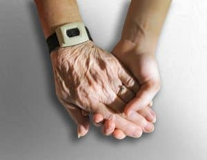 Two hands and a medical alert wristband