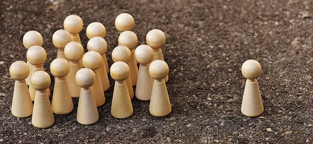 Bullying demonstrated by wooden pins