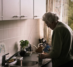 Independently living senior cooking