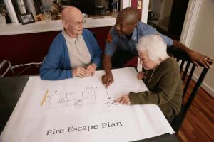 Fire deputy explaining fire escape to seniors