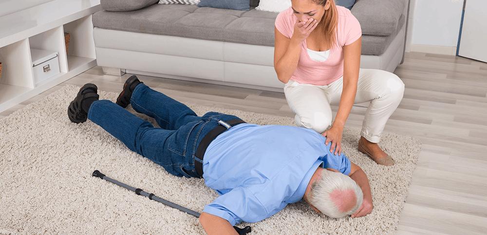 Senior falling before family member