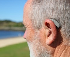 Hearing impaired senior with hearing aid
