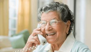 Senior on corded phone