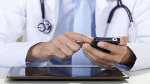A doctr using smartphone and tablet to improve aid giving